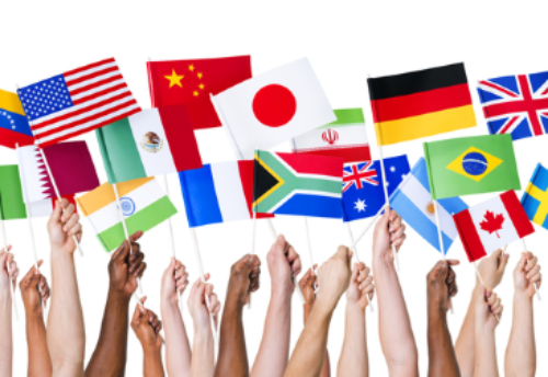 People holding up flags of various countries